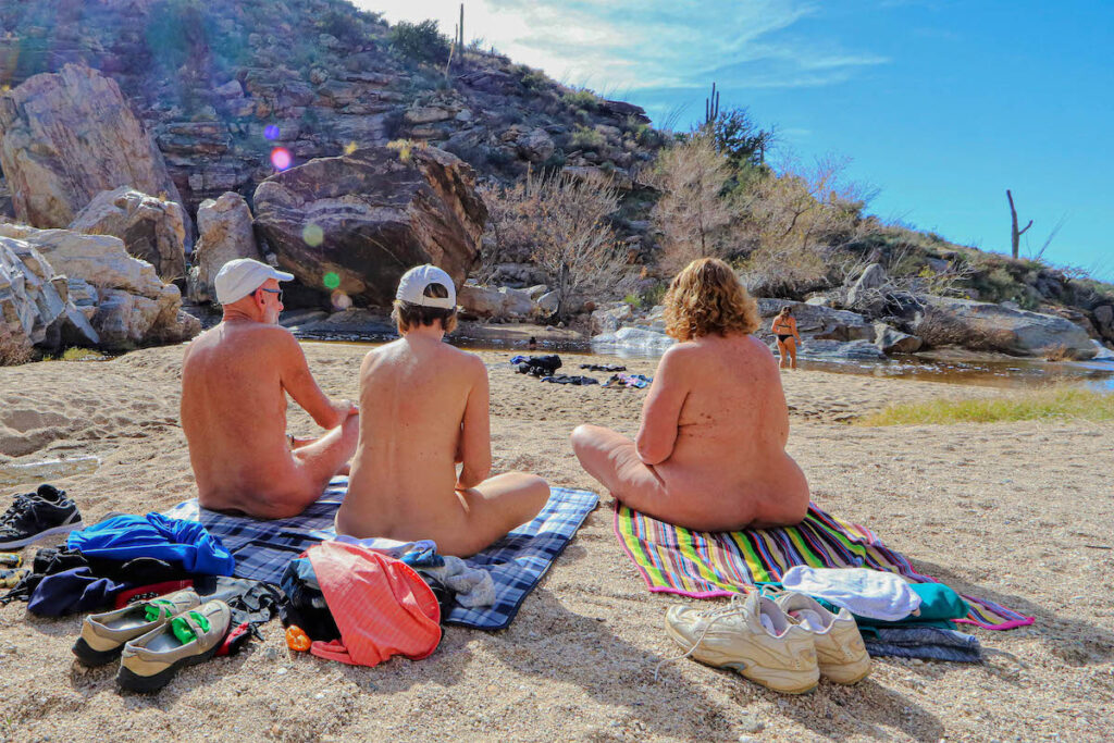 Naturists enjoying a nude beach.