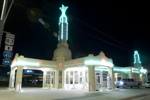 Neon lights shine on the Tower Station and U-Drop Inn Café at night, Shamrock TX