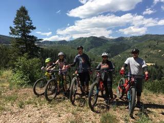 Nicky Omohundro and family on mountain bikes