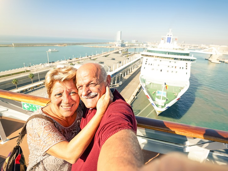 older couple selfie in front of cruise ship
