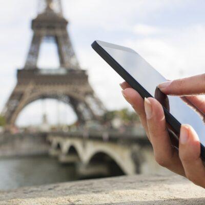 On smartphone in Paris.