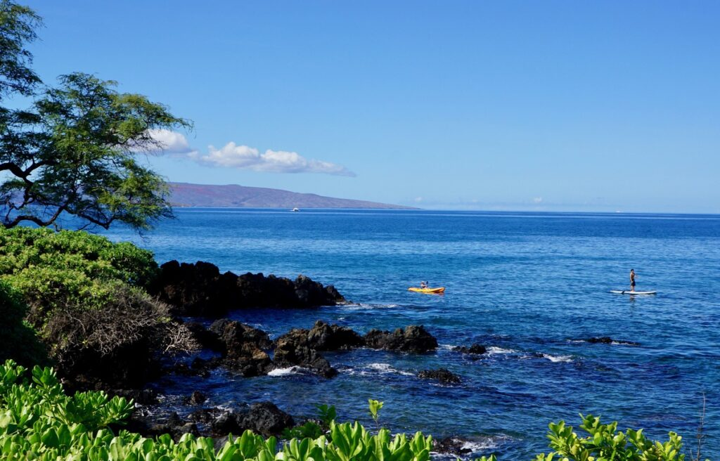 Paddleboarders and kayakers at Wailea Beach.