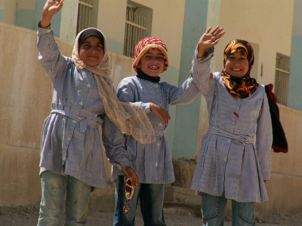 Palestinian children waving.