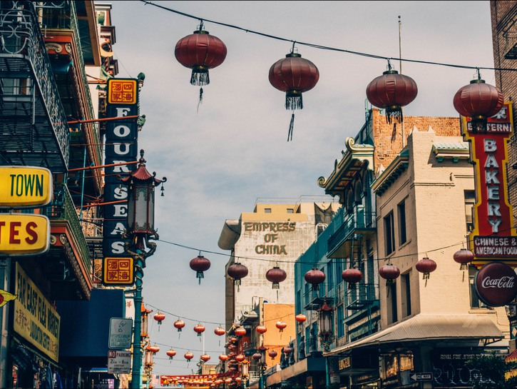Paper lanterns hang over commercial street in Chinatown