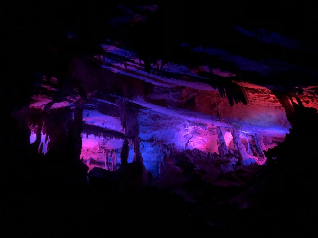 Penn's Cave with colored lights.