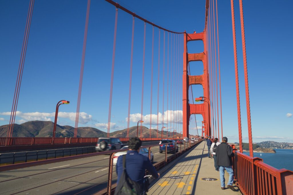 People crossing the Golden Gate Bridge.