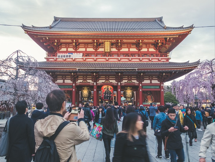 People crowd in front of Senso-ji Buddhist temple
