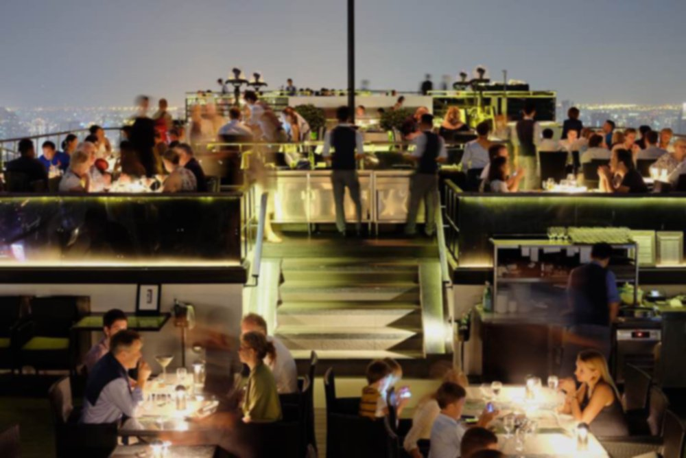 people dining on the deck of a cruise ship
