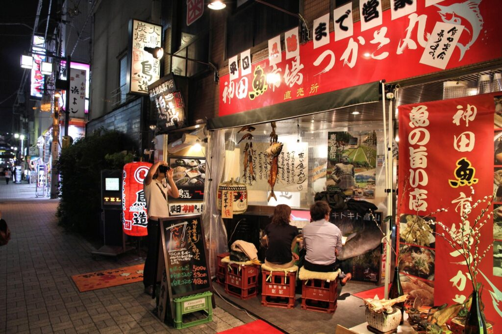 People eating at a sushi shop in Tokyo, Japan.