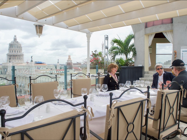 People eating on the rooftop patio, Iberostar Parque Central, Cuba