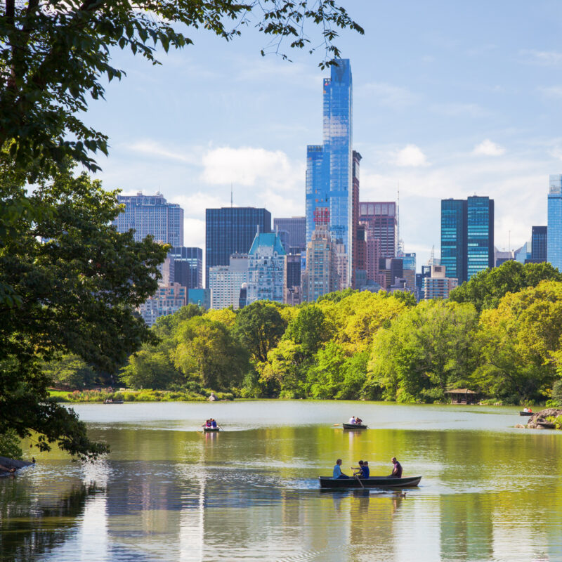 People enjoying the lake in New York City's Central Park.