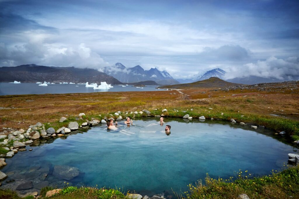 People enjoying the Uunartoq Hot Springs.