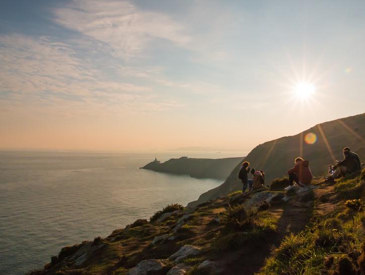 People on the rocky coasts of Ireland.