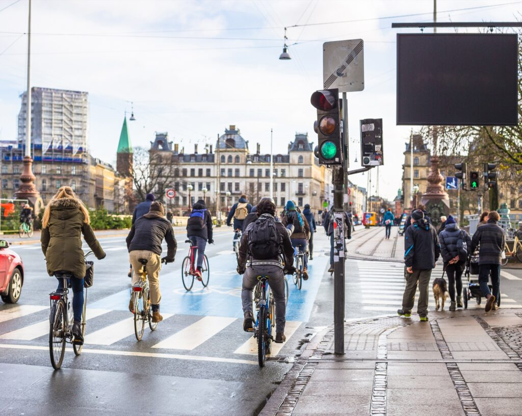 People riding bikes in downtown Copenhagen.
