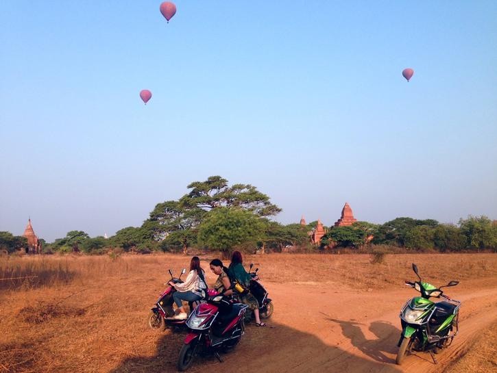 People riding e-bikes in Bagan, Myanmar