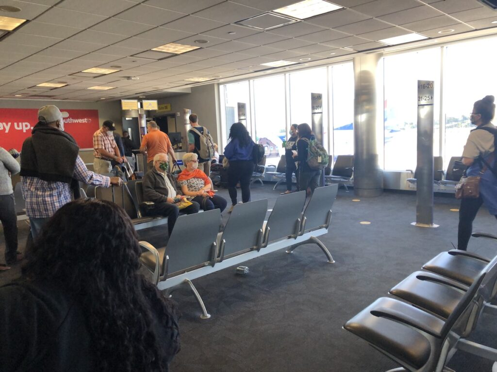 People wearing masks at the airport.