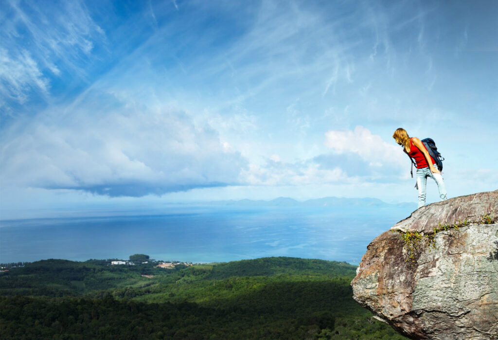 Person standing at the edge of a cliff.