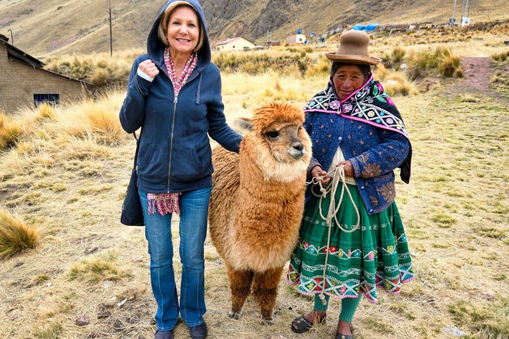 peruvian woman and alpaca