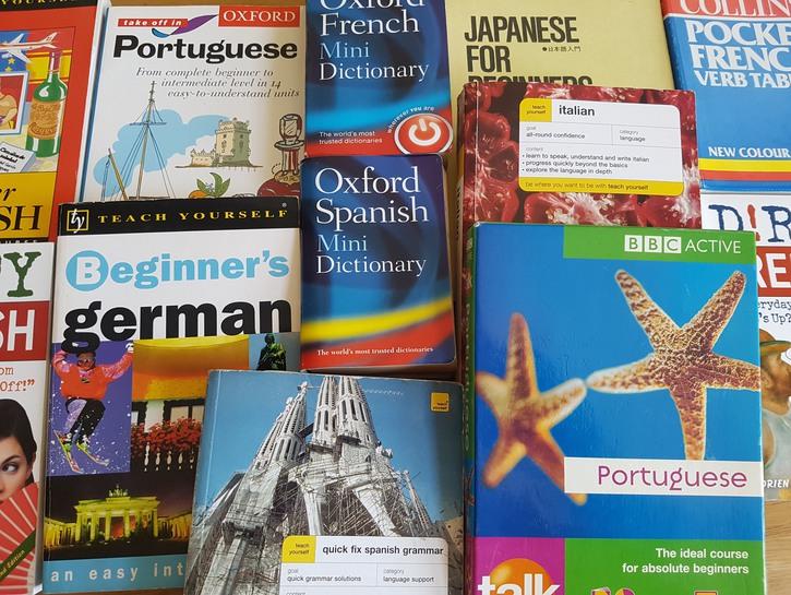 Phrase books of many languages piled