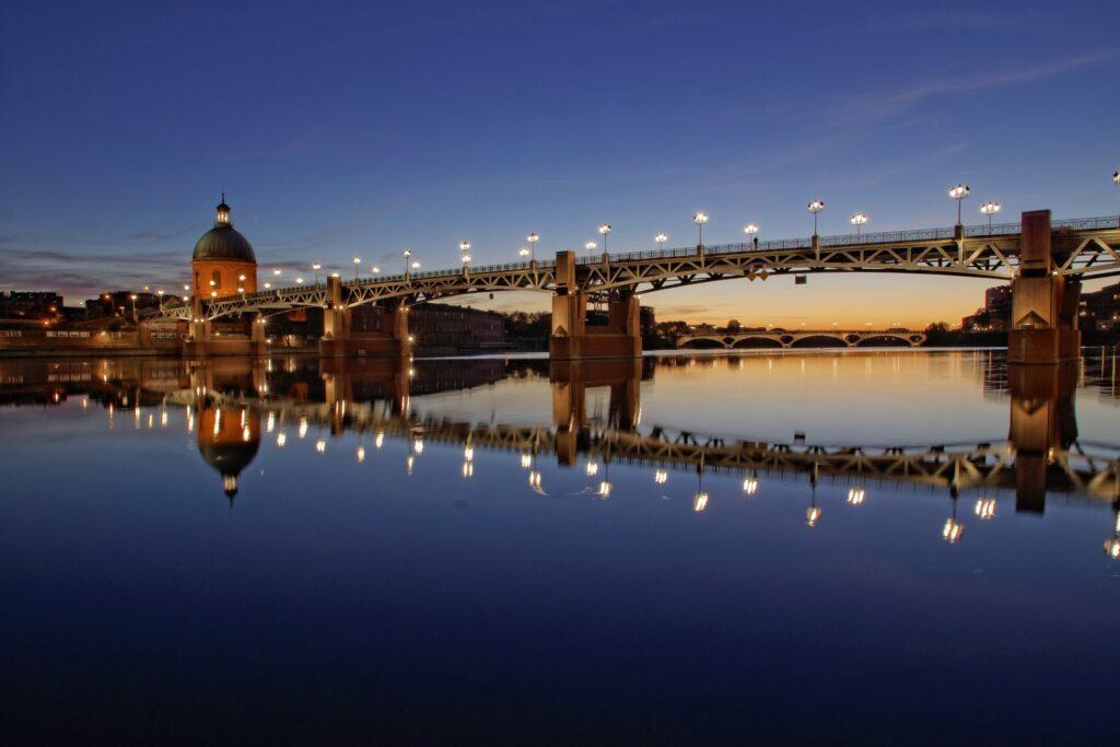 Pont Neuf bridge in Toulouse at sunset.