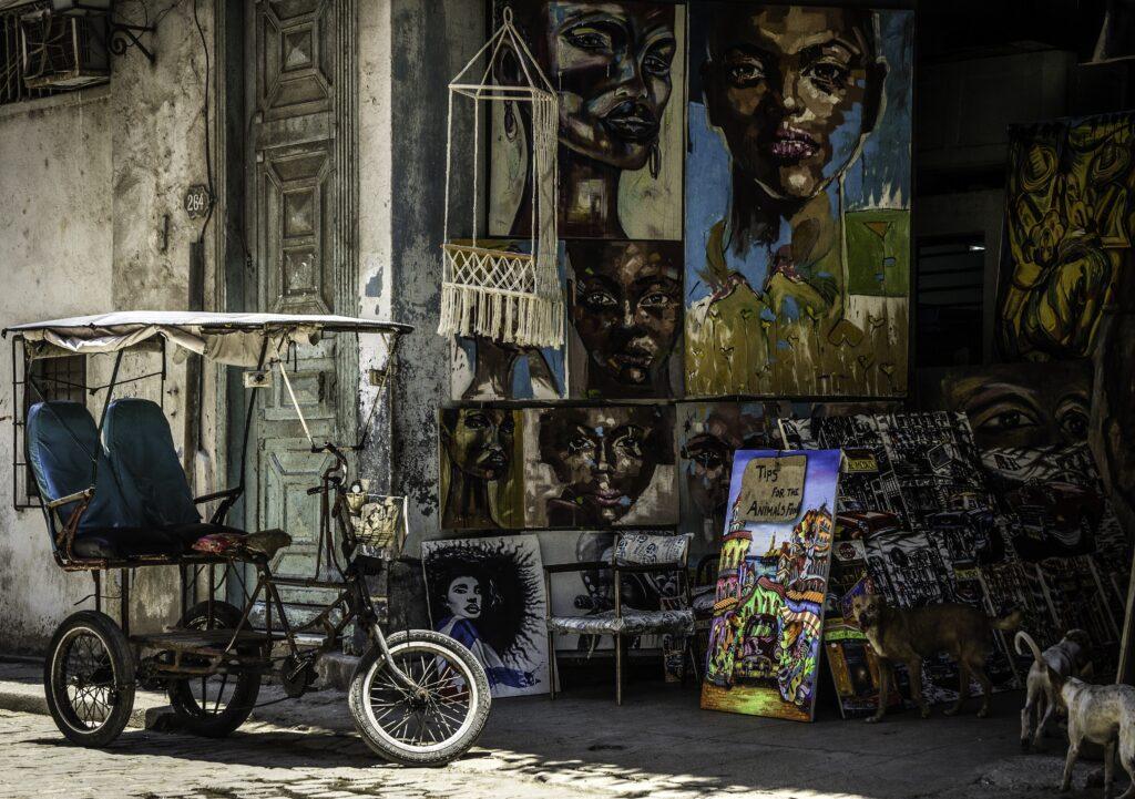 Portrait art displayed on a Havana street
