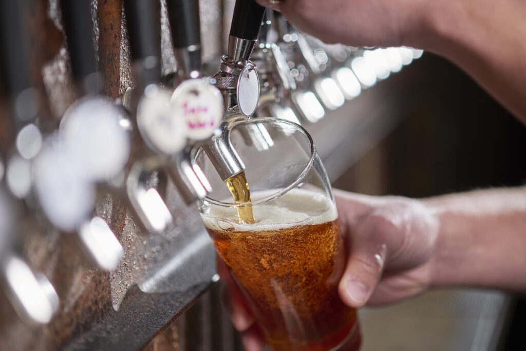 Pouring a craft beer at a brewery.