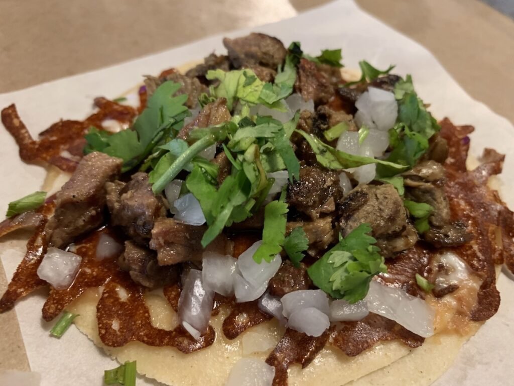Prime rib taco with cilantro, made with Mexican herbs.