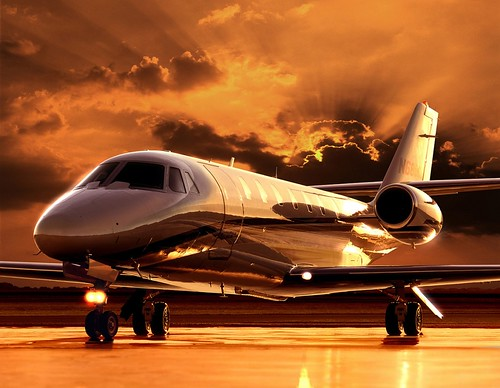 private jet with sunset