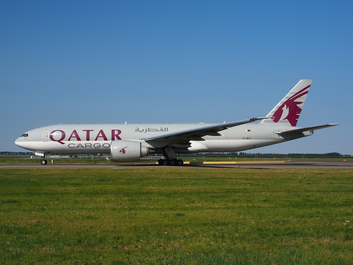 Qatar Airways cargo plane on tarmac.