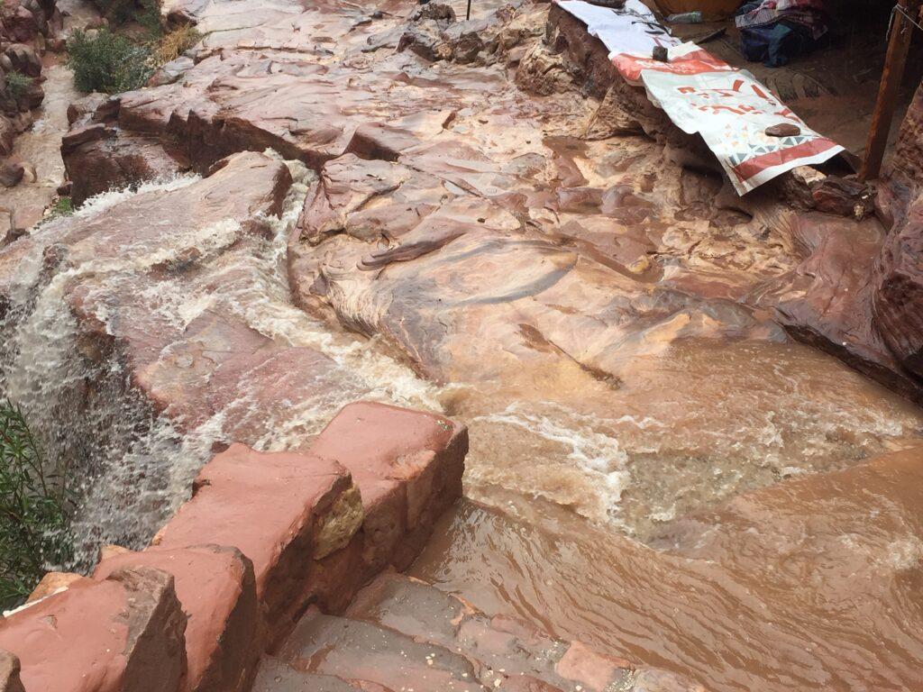 Rain water rushing along a pathway in Petra, Jordan.