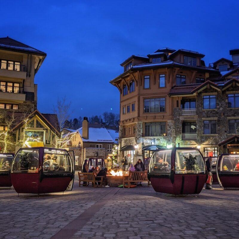 Refurbished gondolas in a city square.