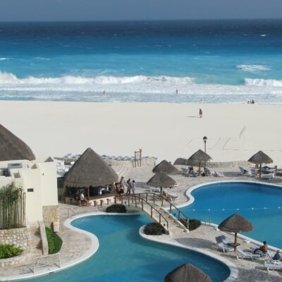Resort beachline and pool in Cancun, Mexico