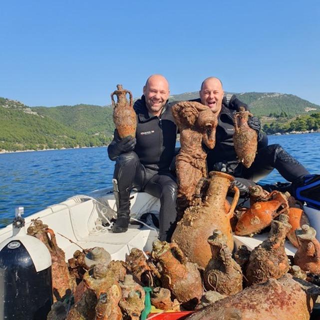 Retrieving underwater wine, Edivo Vina, Croatia.