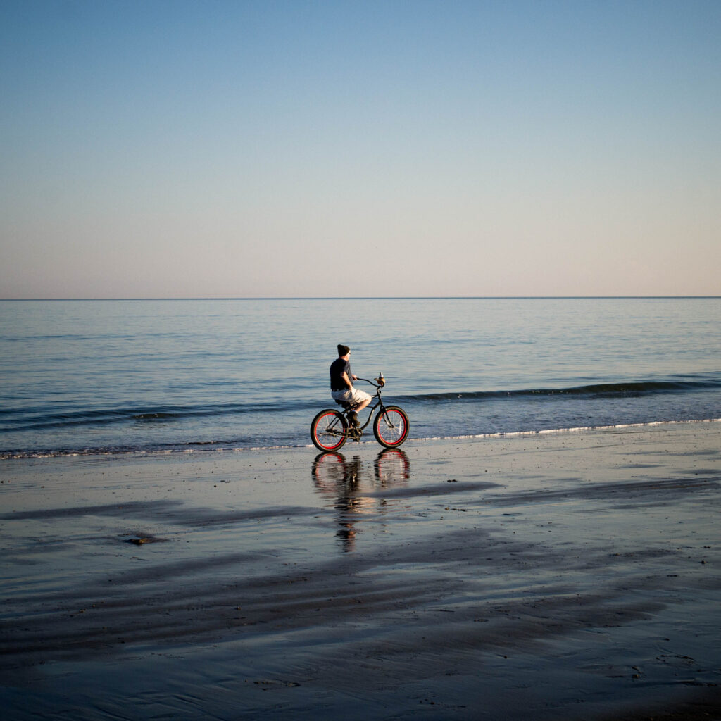 Riding bikes on the beach on Tybee Island.