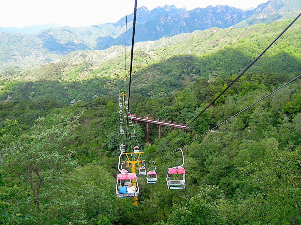 Riding the gondolas to the Great Wall of China.