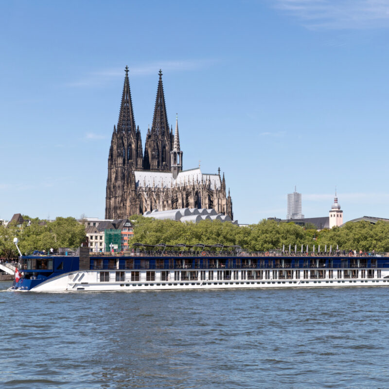 River cruise ship AMASTELLA passing Cologne Cathedral.