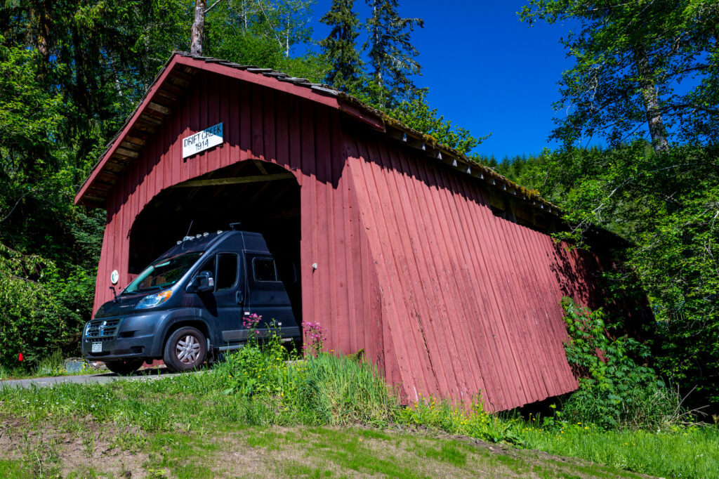 RV drives out of Drift Creek Covered Bridge in Oregon