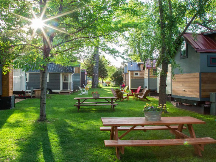 RV mini home in campground with picnic tables