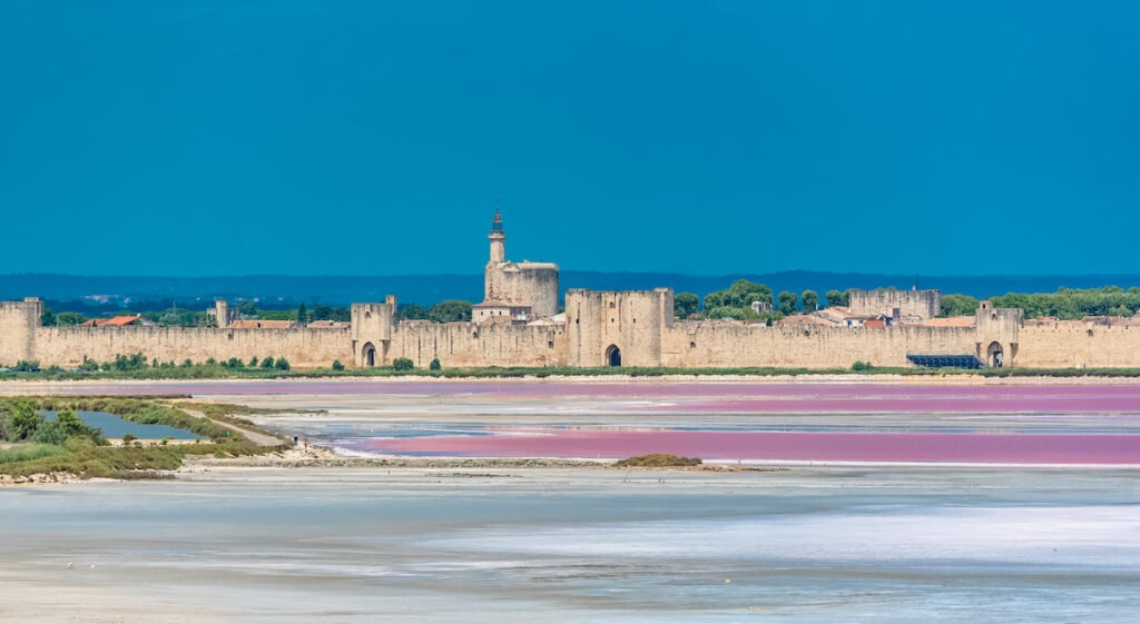 Salt flats and the architecture of Aigues-Mortes in the Camargue.