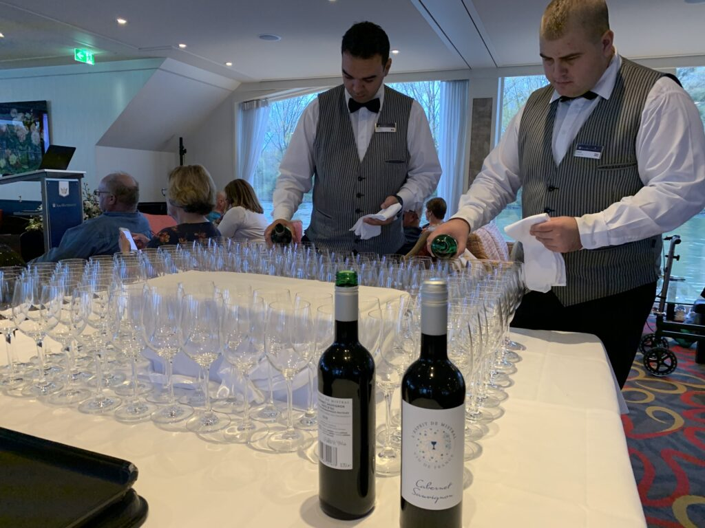Sampling wines on a wine river cruise.