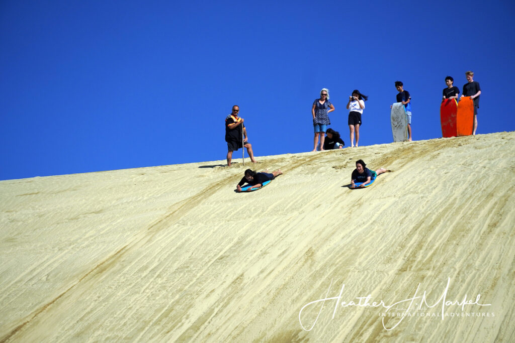 Sandboarding at 90 Mile Beach in New Zealand.