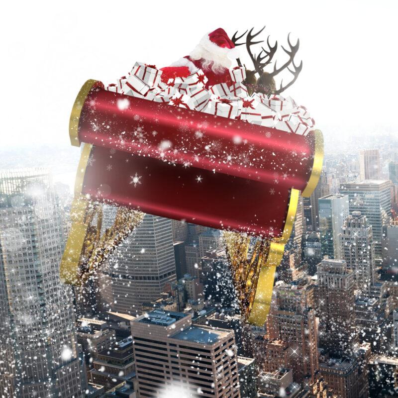 Santa flying over a city.