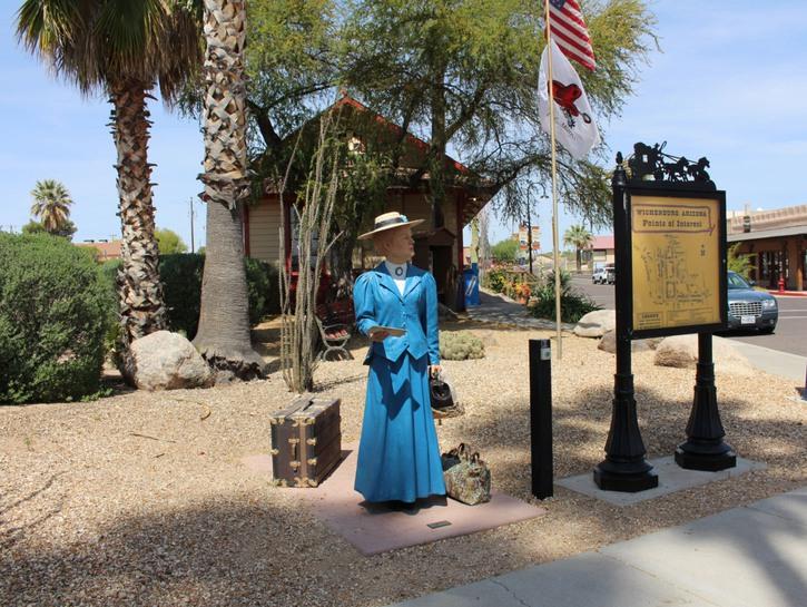 School teacher talking statue outside Wickenburg train station Arizona