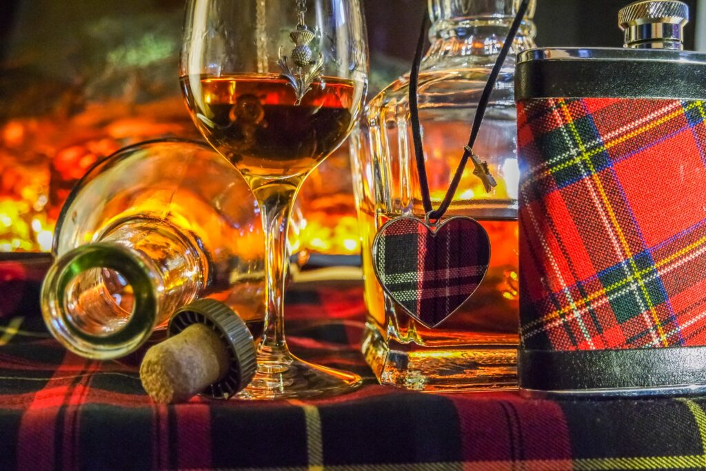 Scottish souvenirs of whiskey and tartan print.