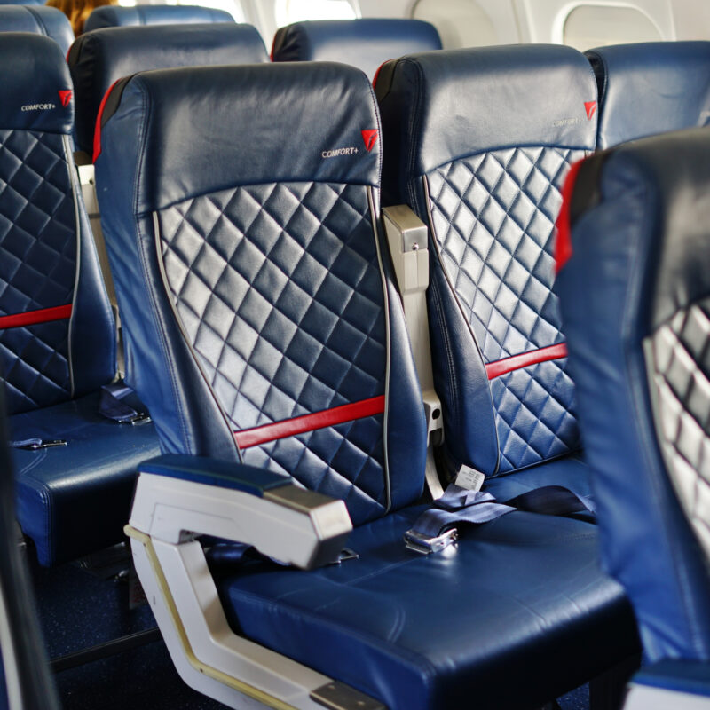 Seats inside of a Delta Airlines plane.