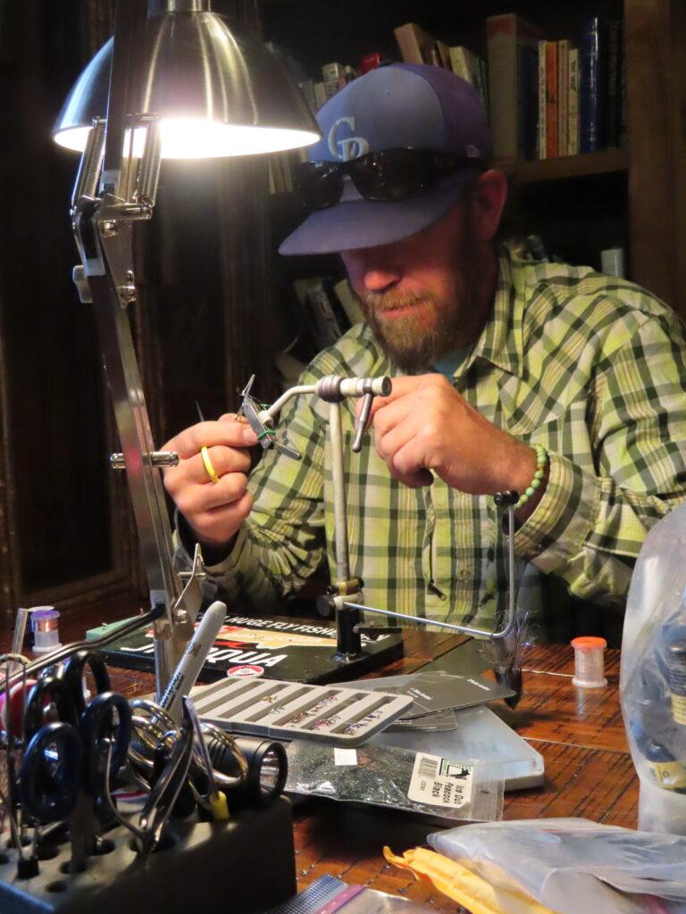 Shea Gunkel creating fly lures.