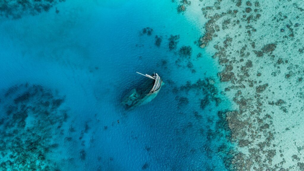 Shipwreck in reef seen from above.