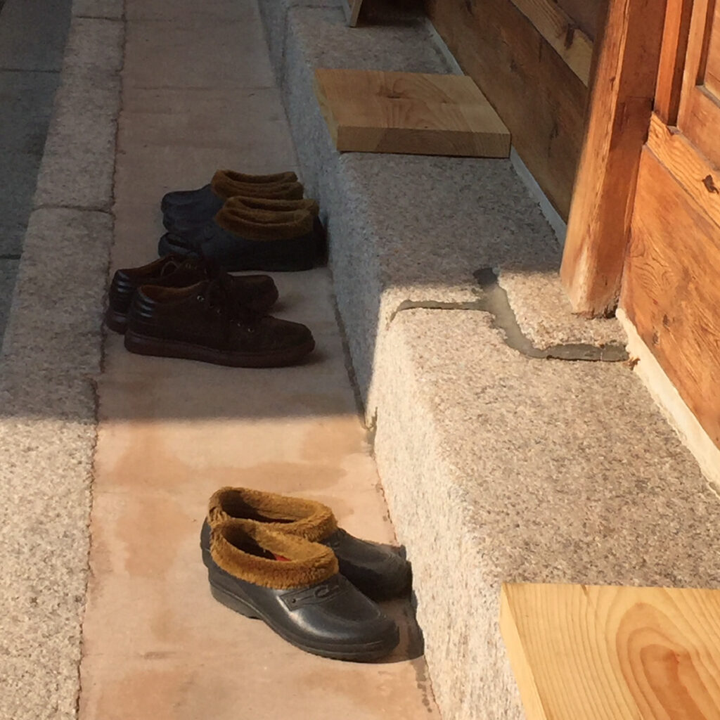 Shoes outside of a traditional home in Seoul.