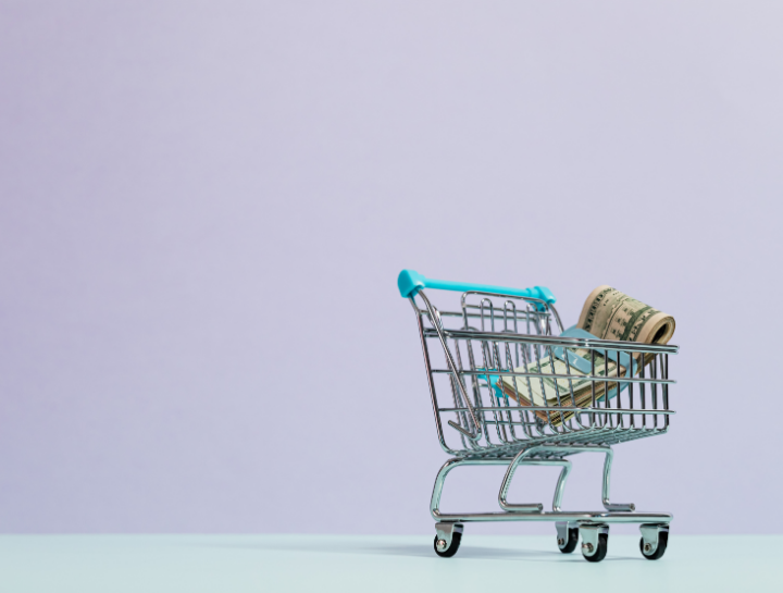 shopping cart with cash in money clip