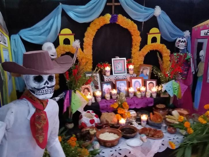 Shrine to the dead with skeleton sculpture and candles, dia de muertos, la paz mexico
